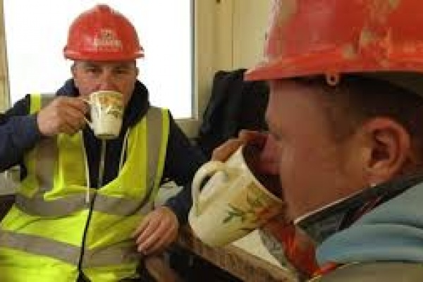 Professional builders with tea